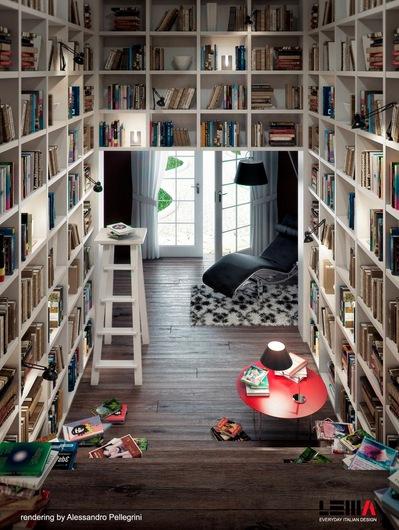階段脇の本棚と階段下のリビング.jpeg