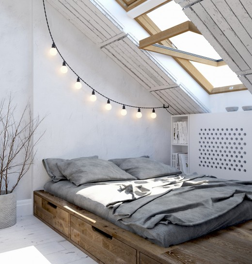 勾配天井の下に30cm程度の台を置いて作った居心地の良さそうなベッドルーム 天窓