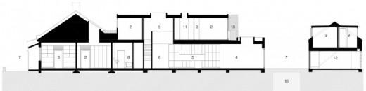 ウッドデッキの回廊のついた細長い箱庭住宅の立面図