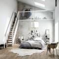 急な階段の上のロフトのあるベッドルーム